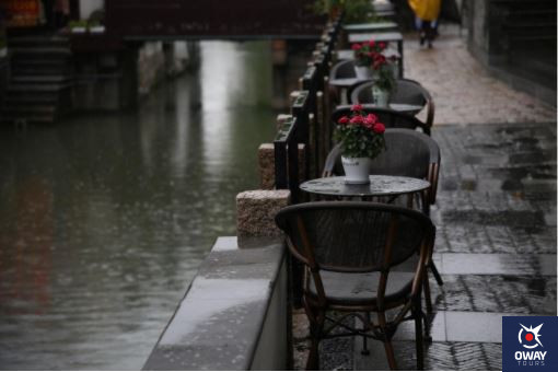 Restaurant tables in the rain Malaga