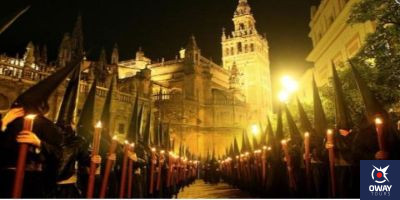 Nazarenes in front of the Giralda Seville