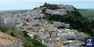 Beautiful views of the village of Casares among the green of the mountains in Mñalaga