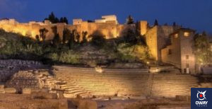 The Roman Theatre with the Alcazaba in the background at night in Malaga