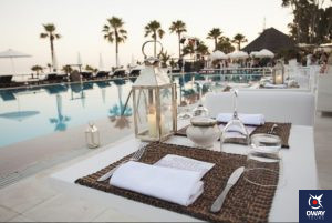 Indoor Puro Beach Club at sunset in front of the pool in Marbella
