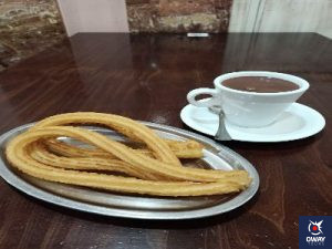 "Breakfast with churros and chocolate in the cafeteria ""Don Pepe""."