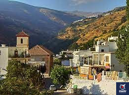 Whitewashed streets in Pampaneira, located in the Alpujarra Granadina.