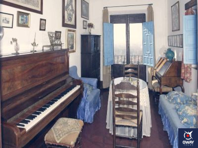 Hall full of the composer's belongings at the Manuel de Falla House-Museum in Granada