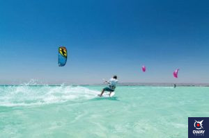 Kitesurfing consists of transforming the force generated by an inflatable kite when flying while a surfboard glides over the water.